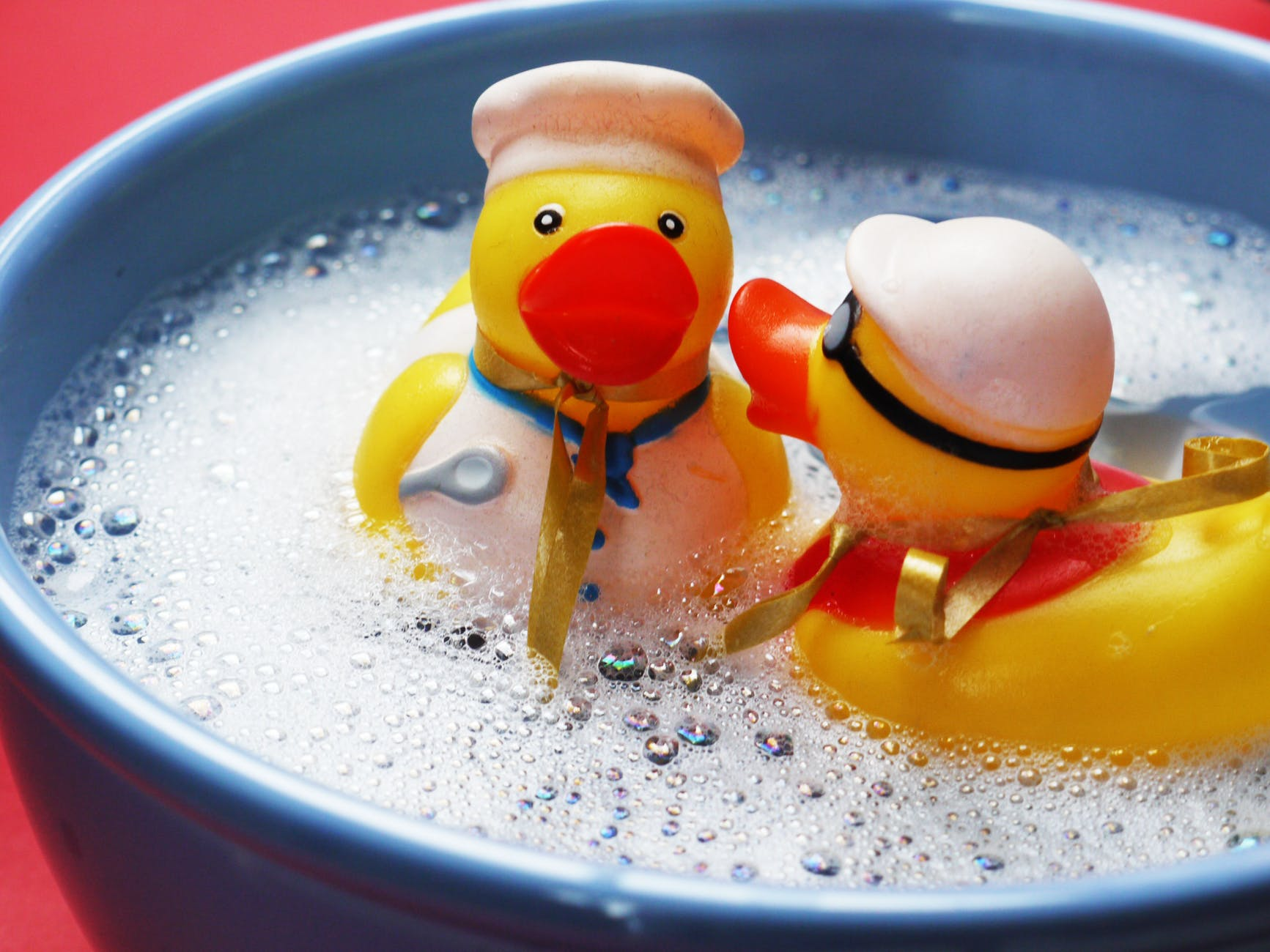 two rubber ducks on water